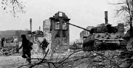 U.S. 14th Armored Division Infantry of the 19th Armored Infantry Bn. with supporting M4 medium tanks from the 47th Tank Bn. (both units of the 14th Armored Division), during the successful drive to Hammelburg, 5 April 1945, following the failed Baum Task Force of March.