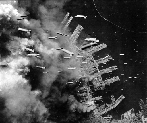 Incendiary bombs are dropped from B-29 Superfortresses of the U.S. Army Air Forces on already-burning landing piers and surrounding buildings in Kobe, Japan, on June 4, 1945. http://www.theatlantic.com/photo/2011/10/world-war-ii-the-fall-of-imperial-japan/100175/