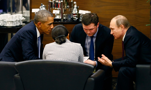 Barack Obama talks to Vladimir Putin during a break of the G20 summit working session in Antalya, Turkey, on Sunday. Photograph: Cem Oksuz/EPA