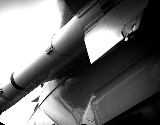 An AIM-9 Sidewinder Missile installed on an F-14 Tomcat. The AIM-9 is a short range, heat seeking air-to-air missile.